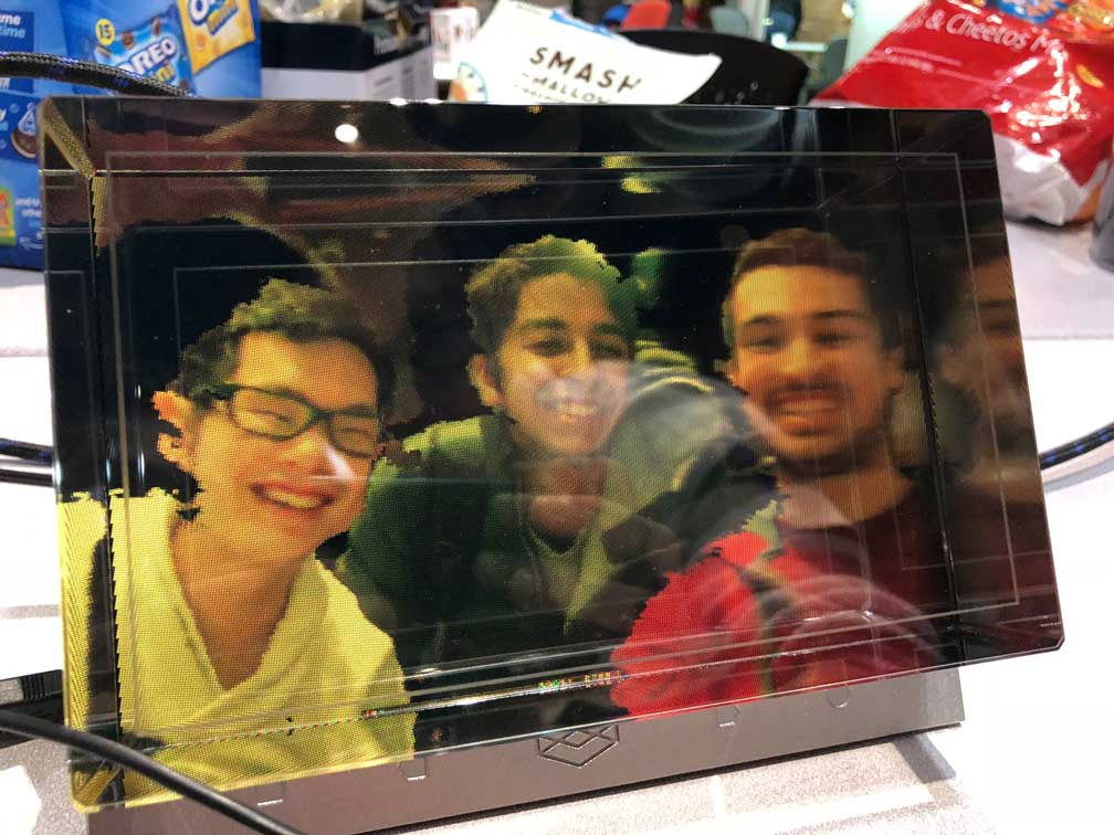 Photo of the holographic display showing a 3D view of its creators, Phillip, Kumail and Cyrus